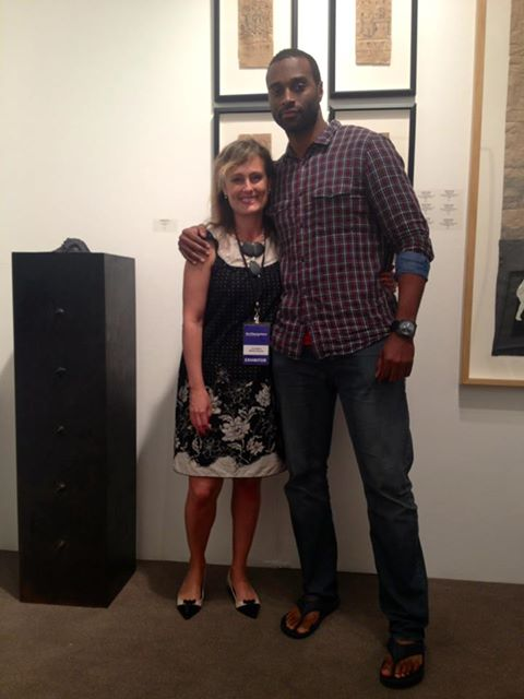 "Amy Morton and STEPHON SENEGAL at ArtHamptons. Stephon Senegal ""019"", 52""x13""x13"", bronze sculpture"
