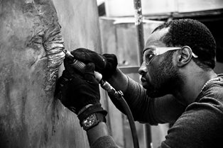Stephon Senegal sculpting in bronze, photo credit: Stephon Senegal